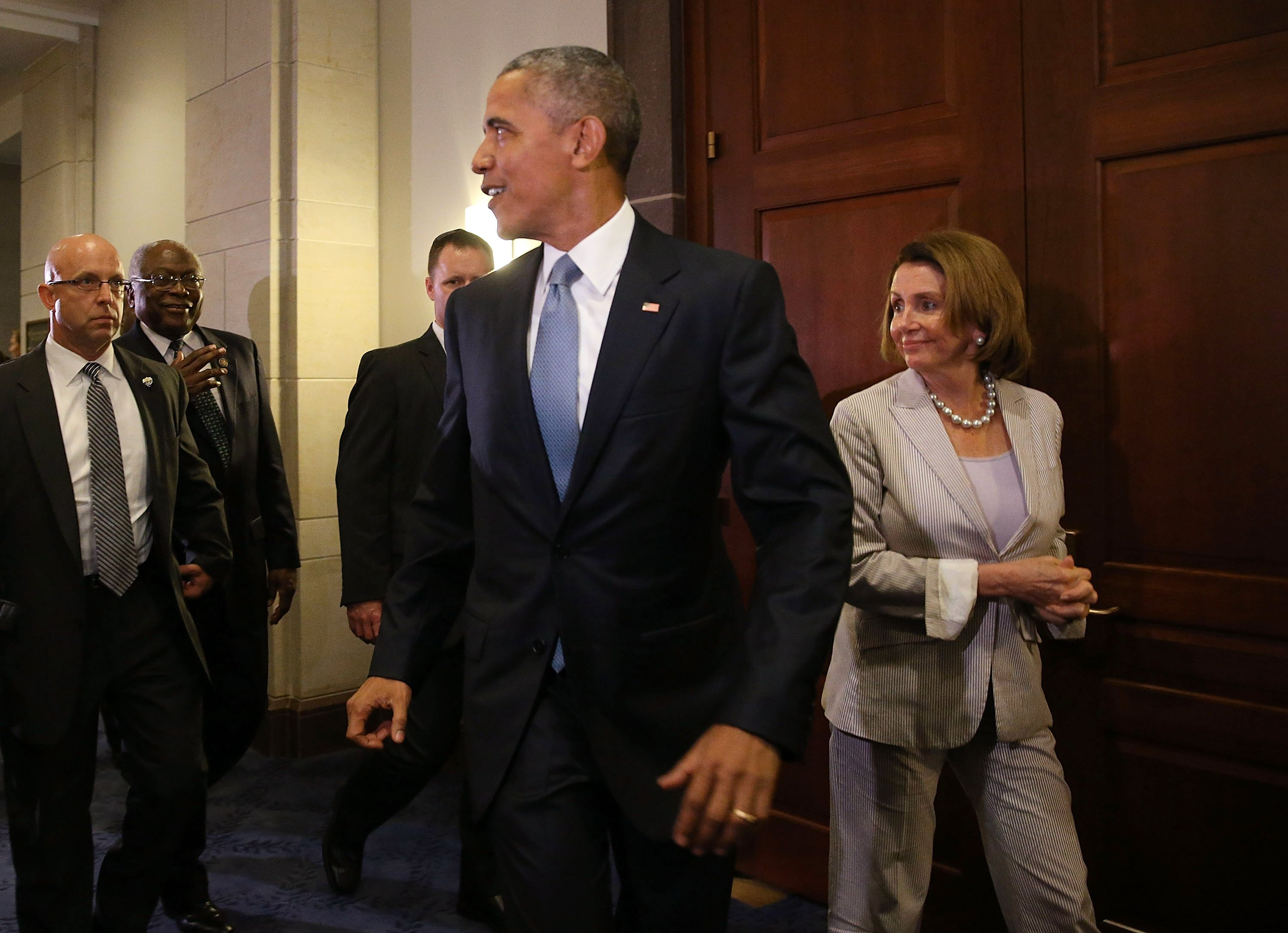 Barack Obama and Nancy Pelosi following a after a meeting with House Democrats at Capitol Hil in 2015 | Photo: Getty Images