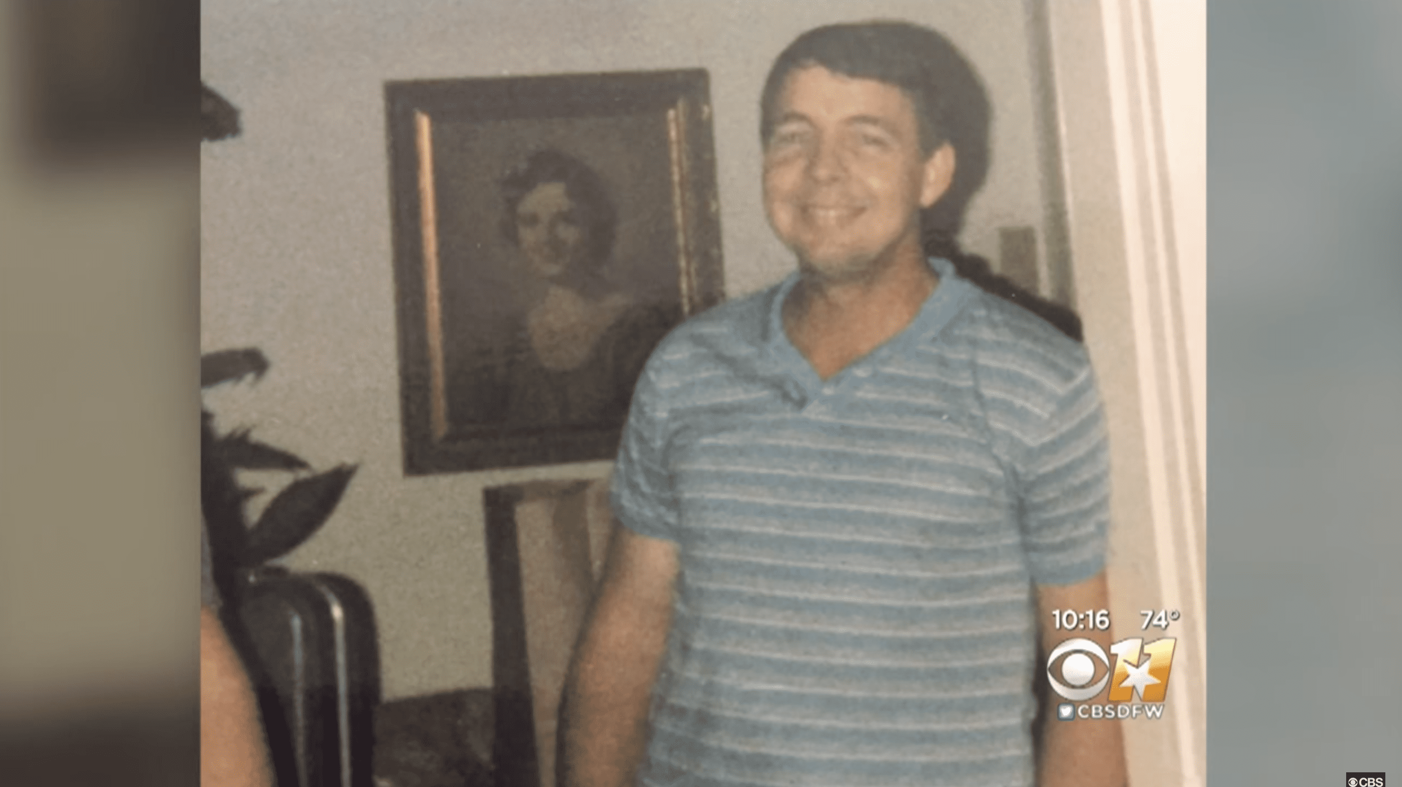 Betsy's daughter showed a photo of her stepfather standing in front of the painting as proof to the bar owner.   Photo: YouTube.com/CBSDFW