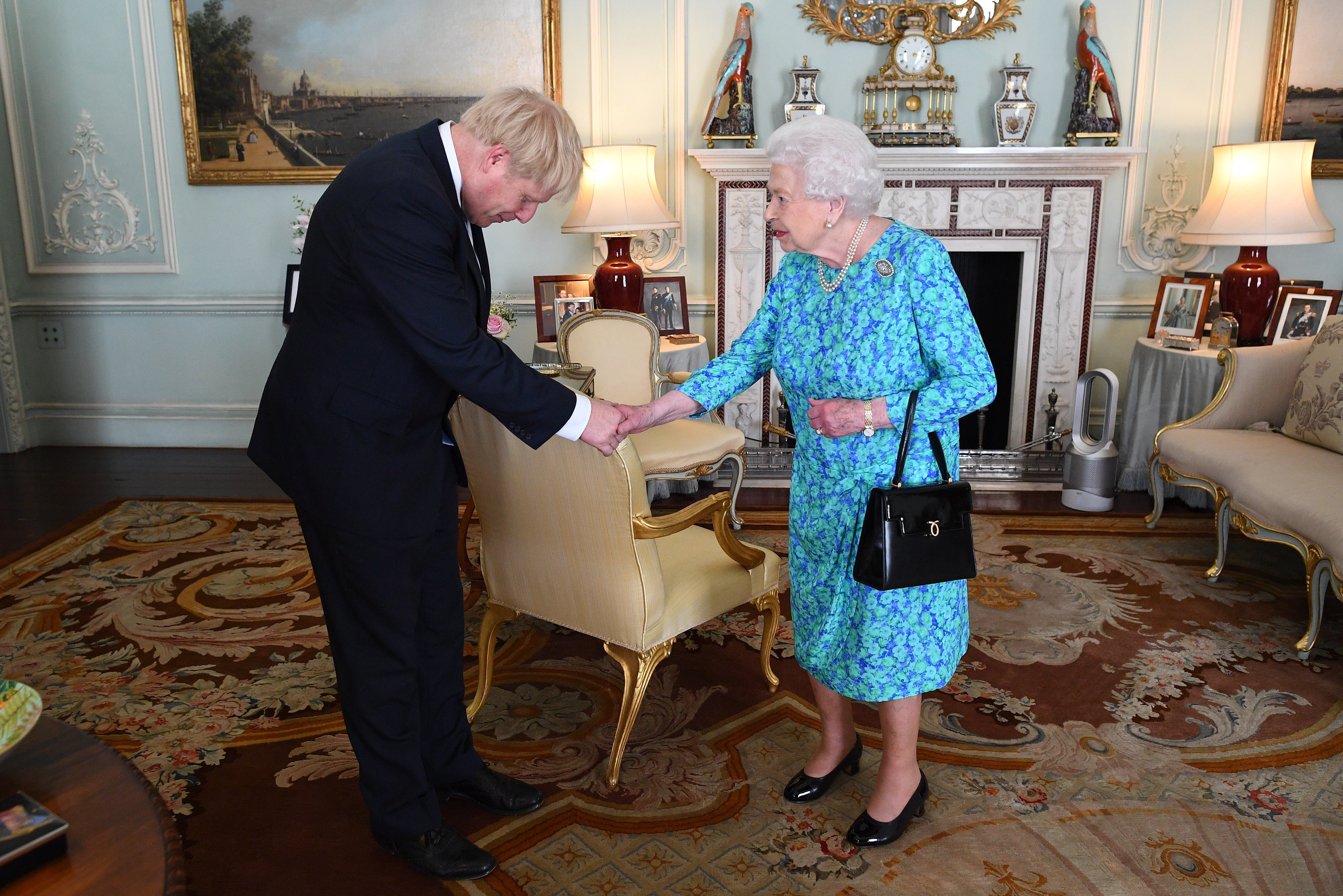 Queen Elizabeth II greets the Prime Minister of the United Kingdom, Boris Johnson in July 2019 | Photo: Getty Images