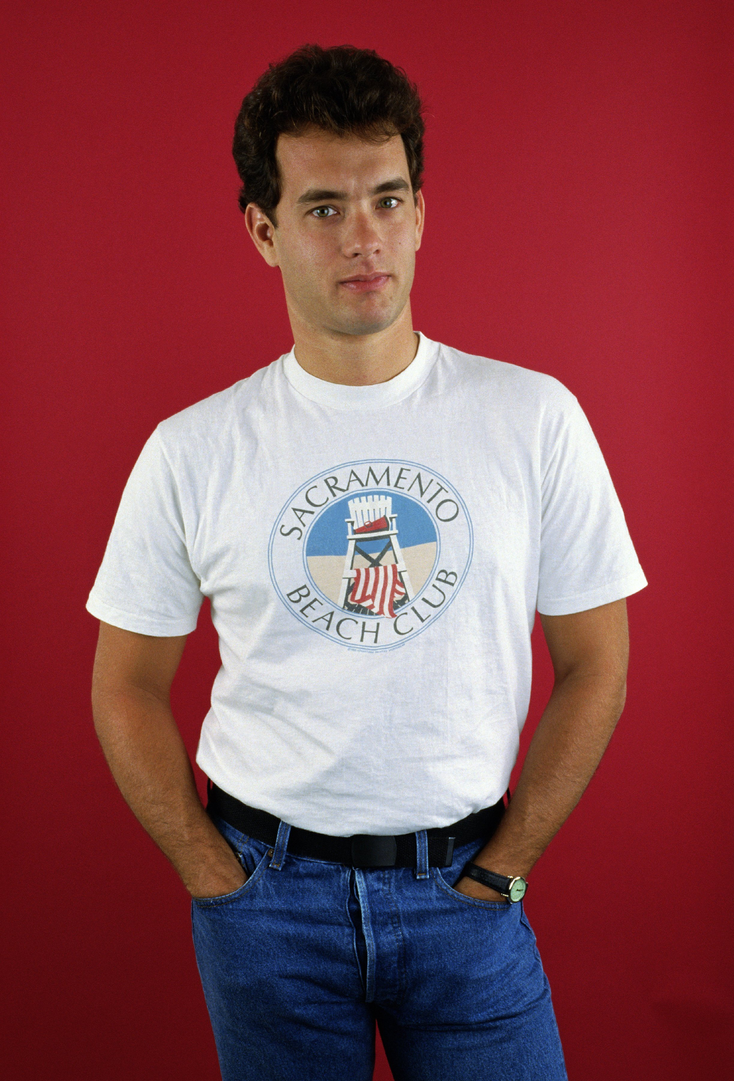 """Tom Hanks poses during a 1986 West Hollywood, California studio portrait session to promote his newest movie """"The Money Pit."""" 
