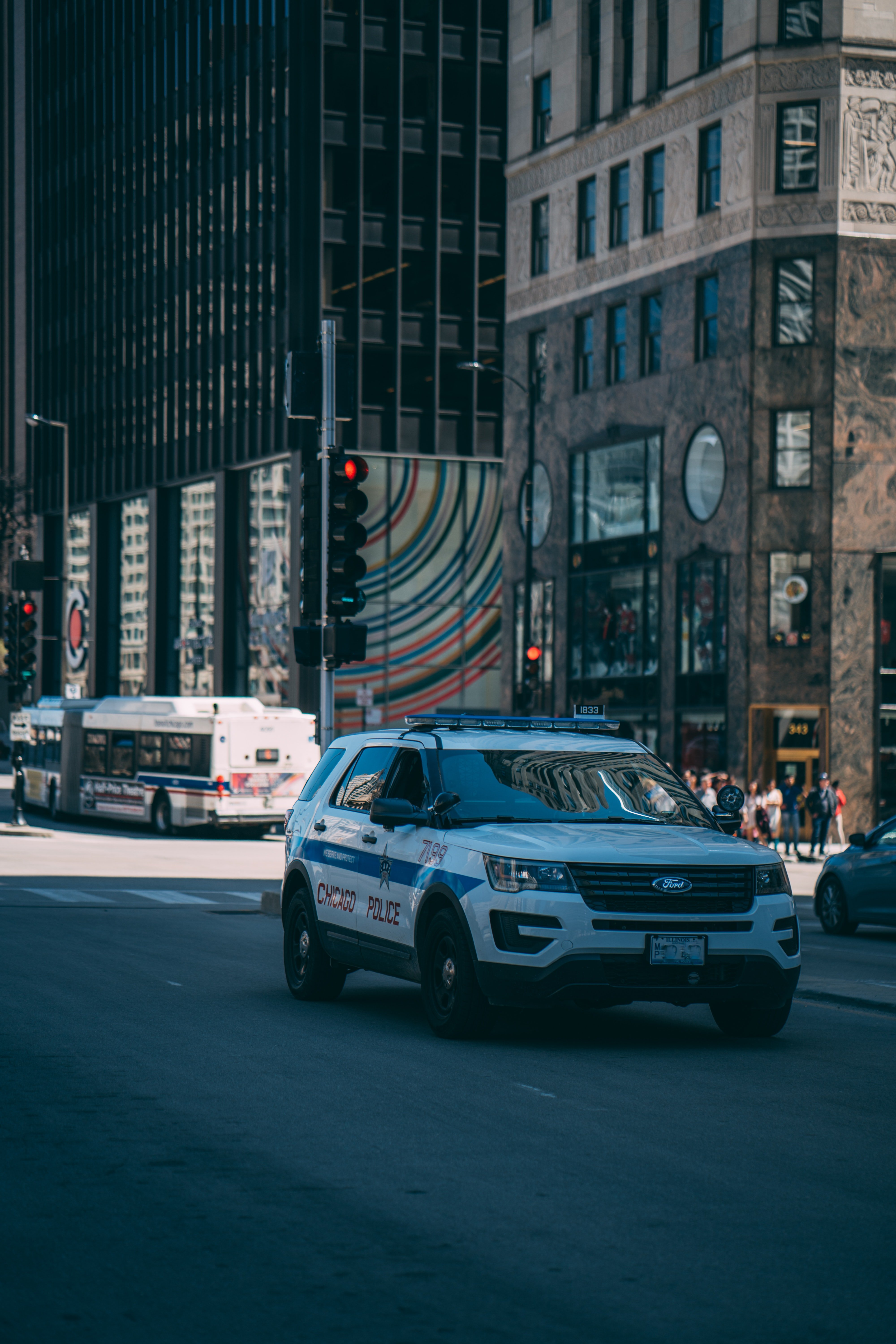 Pictured - A white police SUV passing by in the city | Pexels