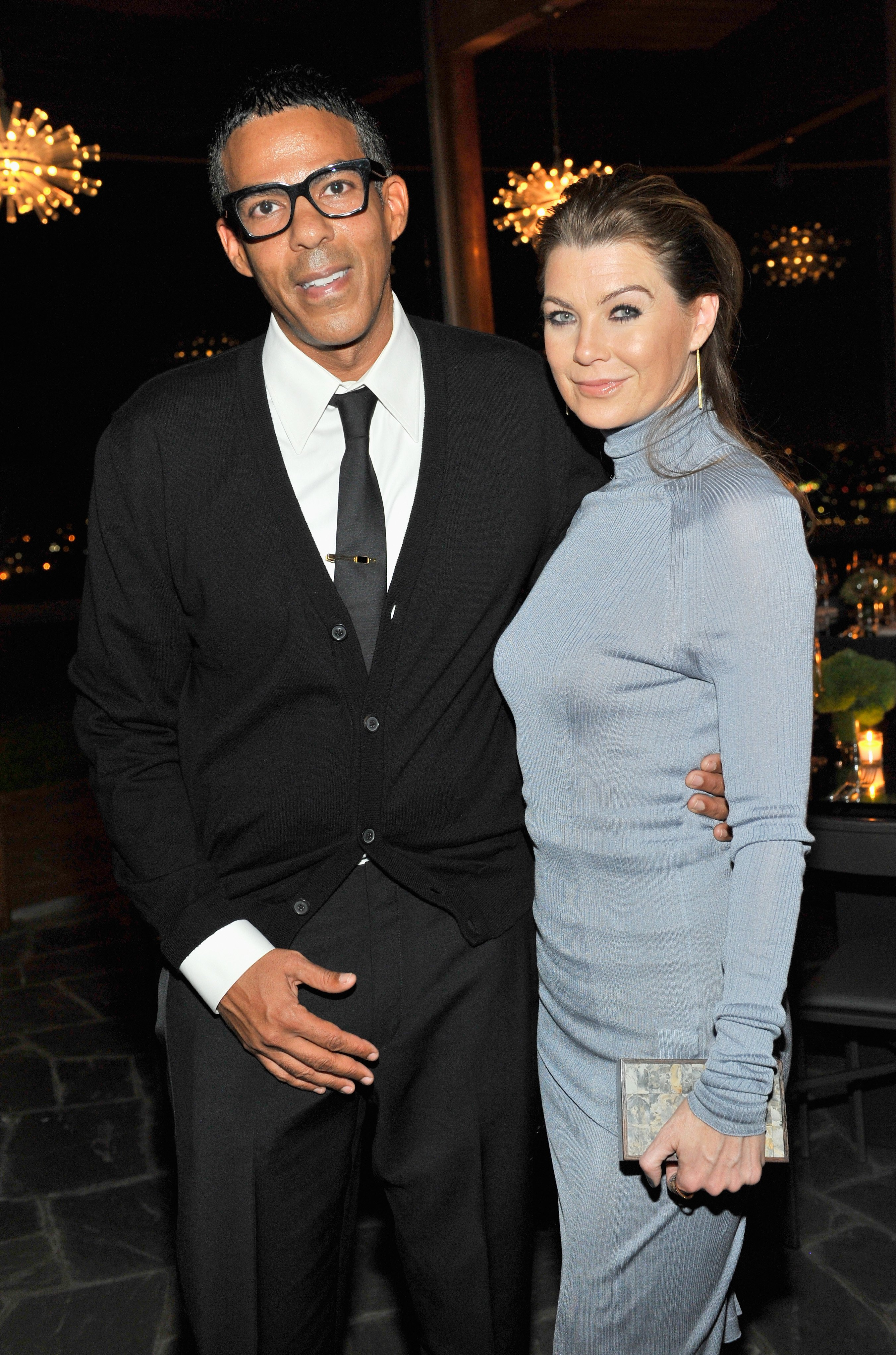 Music producer Chris Ivery (L) and actress Ellen Pompeo attend a private dinner hosted by VOGUE to celebrate TOD'S Creative Director Alessandra Facchinetti on November 5, 2014, in Los Angeles, California. | Source: Getty Images.