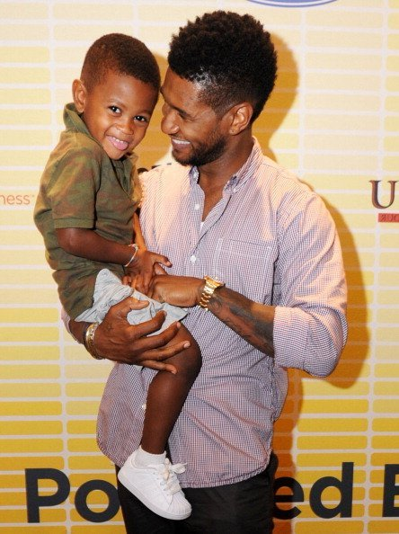 Usher (R) and his son, Usher Raymond V, attend Usher's New Look Foundation - World Leadership Conference & Awards 2011 - Day 2 at Cobb Galleria on July 21, 2011, in Atlanta, Georgia. | Source: Getty Images.