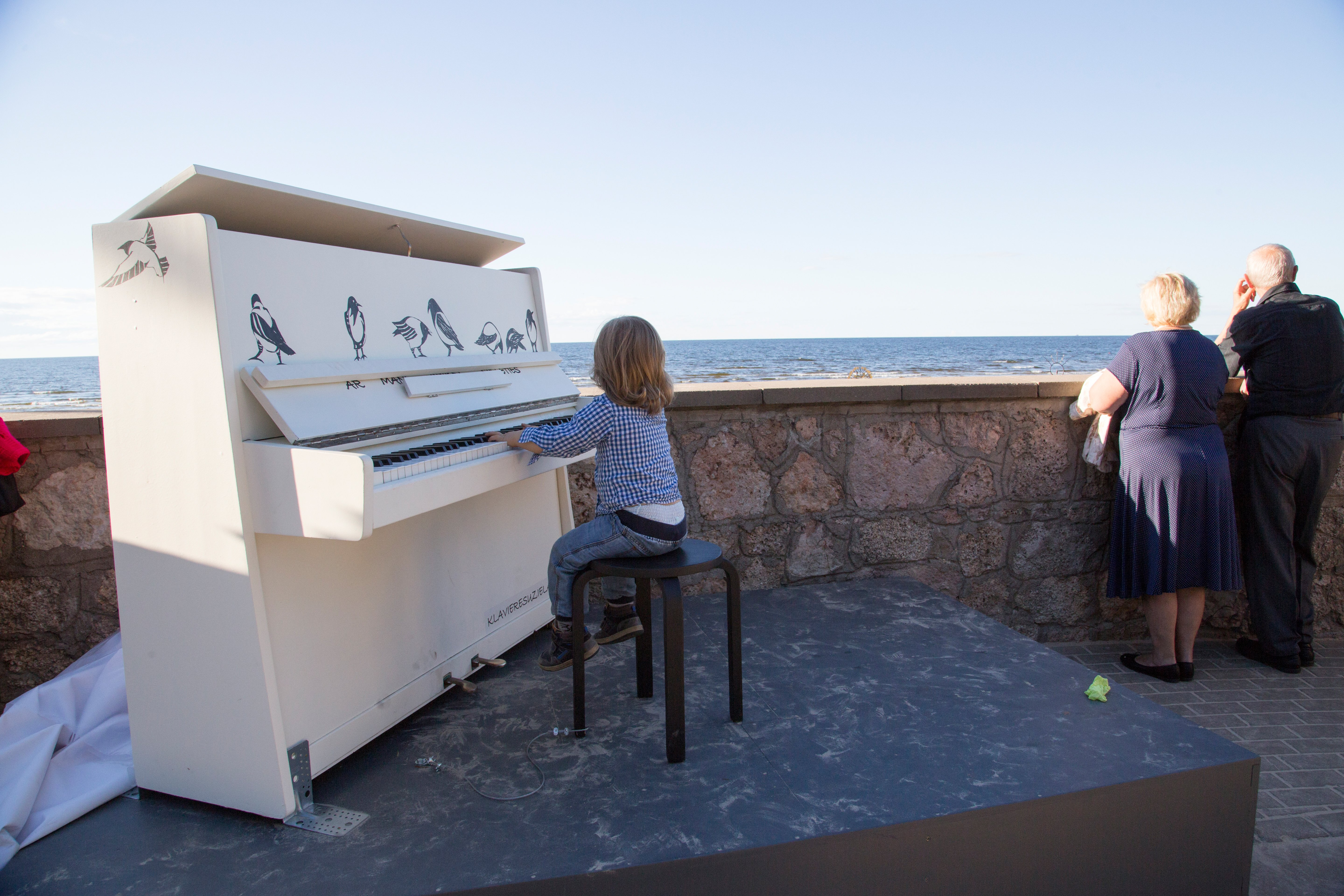 A boy plays piano at the Latvian Baltic Sea beach Jurmala. With a panoramic view of the sea,|Photo: Getty Images