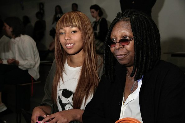 Whoopi Goldberg and her grand daugther Jerzey attend Jeremy Scott's fashion show during MADE Fashion Week Spring 2015 at Milk Studios | Photo: Getty Images