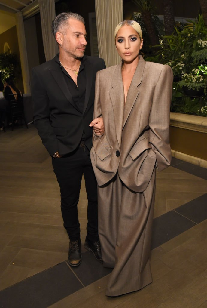 Christian Carinonand Lady Gaga attend ELLE's 25th Annual Women In Hollywood Celebration presented by L'Oreal Paris, Hearts On Fire and CALVIN KLEIN at Four Seasons Hotel Los Angeles at Beverly Hills | Photo: Getty Images