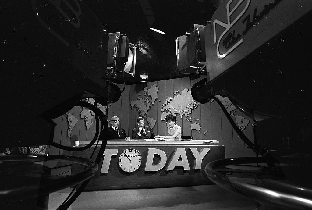 View of the desk on the set of the 'Today' show during filming, New York, New York, 1966. Pictured are, from left, author Harry Golden (1902 - 1981), and broadcast journalists Hugh Downs and Barbara Walters.   Source: Getty Images