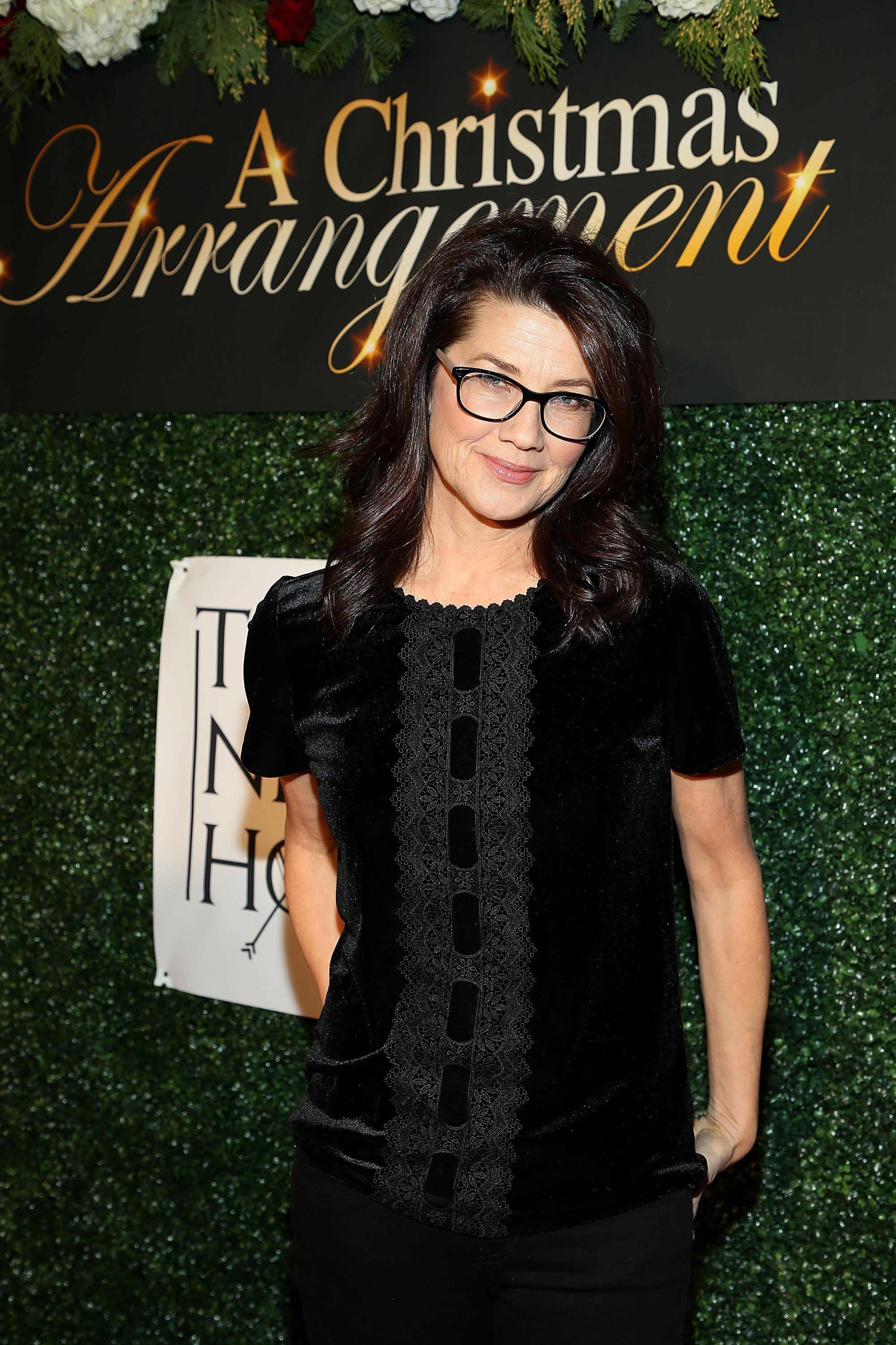 """Daphne Zuniga attends """"A Christmas Arrangement"""" Los Angeles premiere at Garry Marshall Theatre on November 14, 2018, in Burbank, California. 
