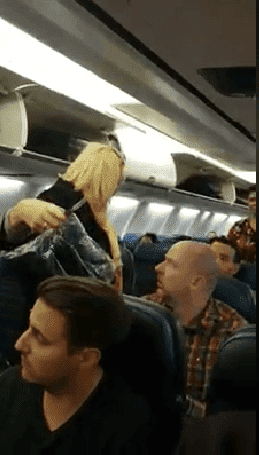 Fellow passengers demanded the woman to be removed from the flight. | Source: Facebook/Smash Da Topic Breaking News