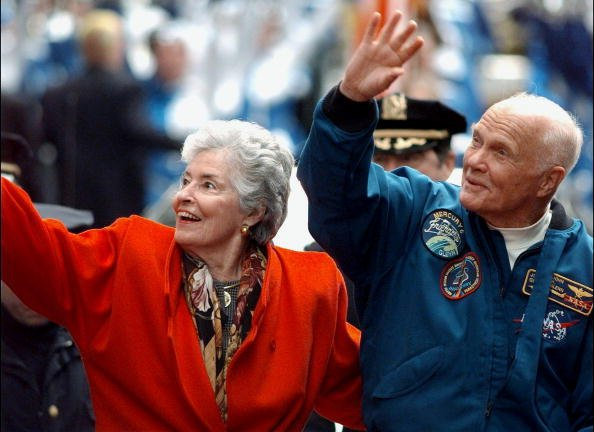 John Glenn and Annie greet crowd from open car in parade up lower Broadway honoring Glenn and crew of the Discovery space shuttle, undated image. | Photo: Getty Images