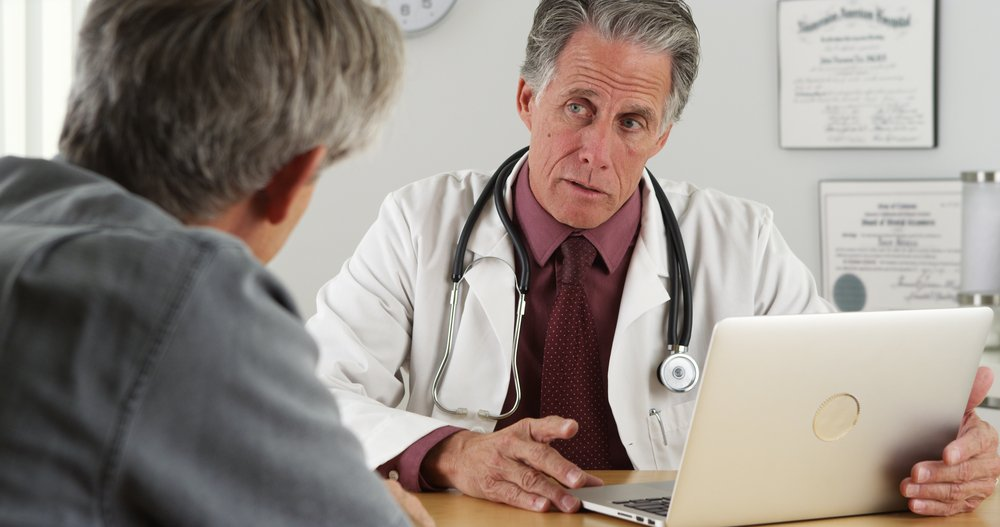 Senior man with medical doctor. | Source: Shutterstock