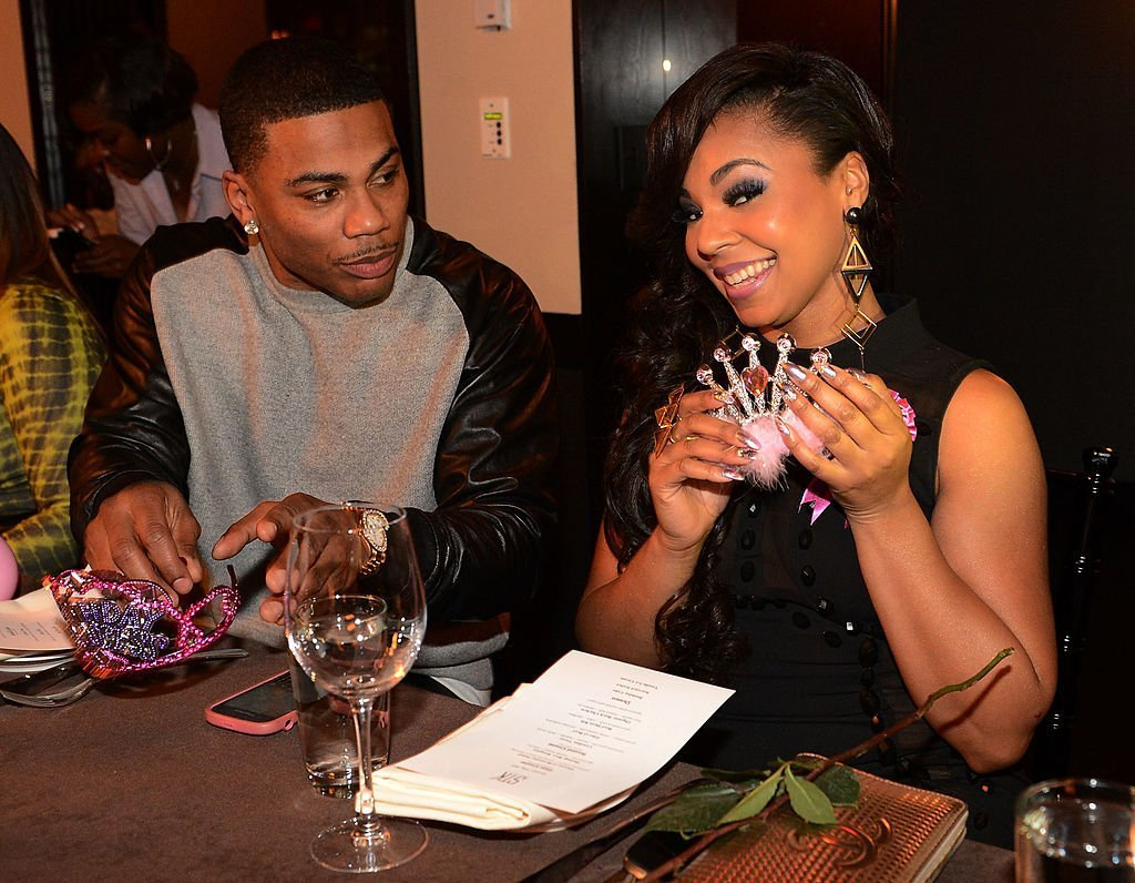 Recording Artists Nelly and Ashanti during Ashanti's surprise birthday dinner hosted by Nelly at STK | Photo: Getty Images