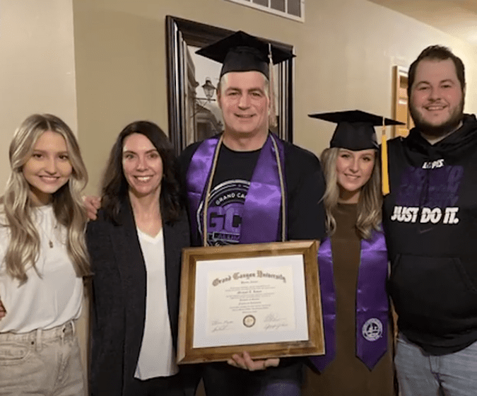 Mike Loven (center) celebrated his graduation from GCU with (from left) daughter-in-law Annie, wife Carrie, daughter Taleigh and son Austin. | Source: Facebook/Good Morning America