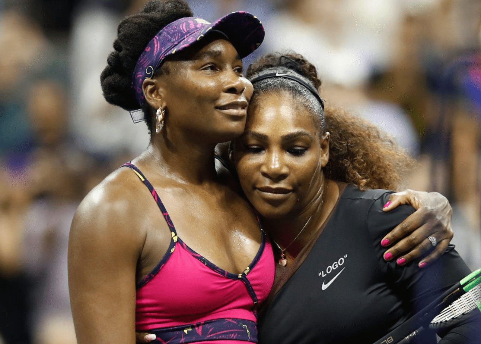 Serena Williams and sister Venus Williams share a hug after their third round match in the US Open on August 2018. | Source: Getty Images