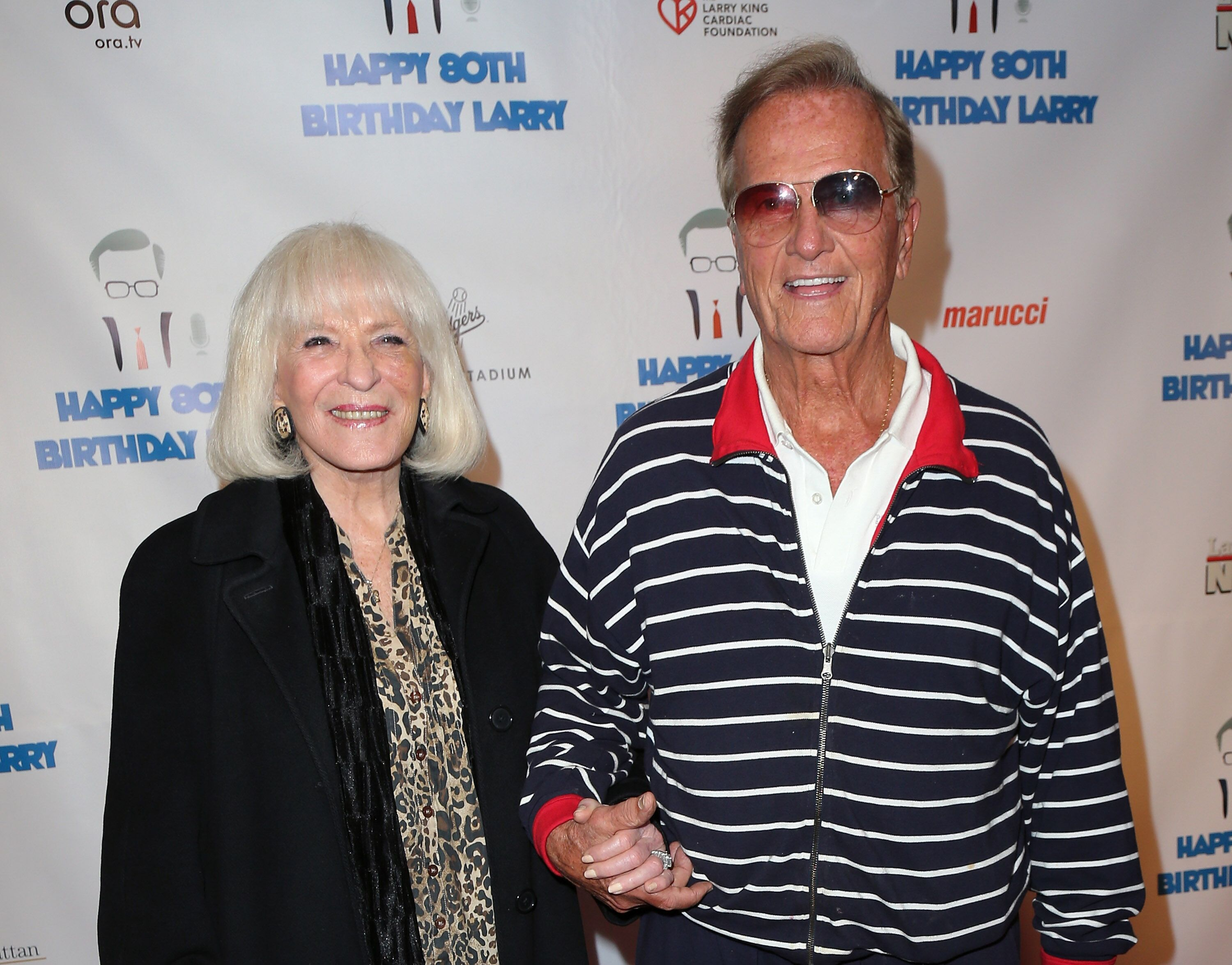Pat Boone and wife Shirley Boone at Larry King's 80th birthday surprise party in Los Angeles in 2013 | Source: Getty Images