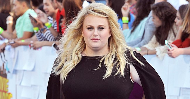 Rebel Wilson Puts Her Slim Figure on Display in a Black Skintight Sweatsuit at a Park