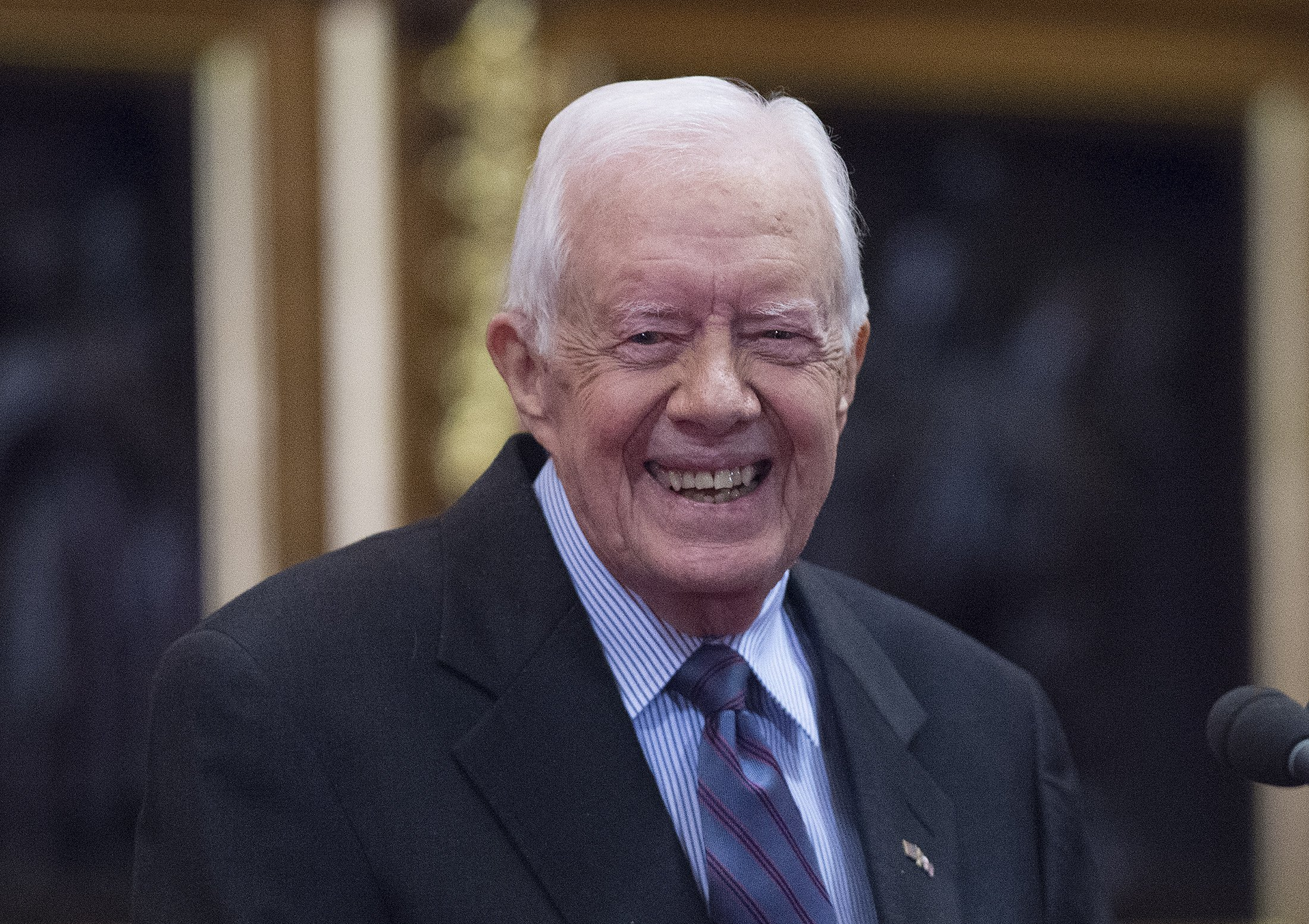 Former U.S. President Jimmy Carter receives delivers a lecture on the eradication of the Guinea worm, at the House of Lords on February 3, 2016, in London. | Source: Getty Images.