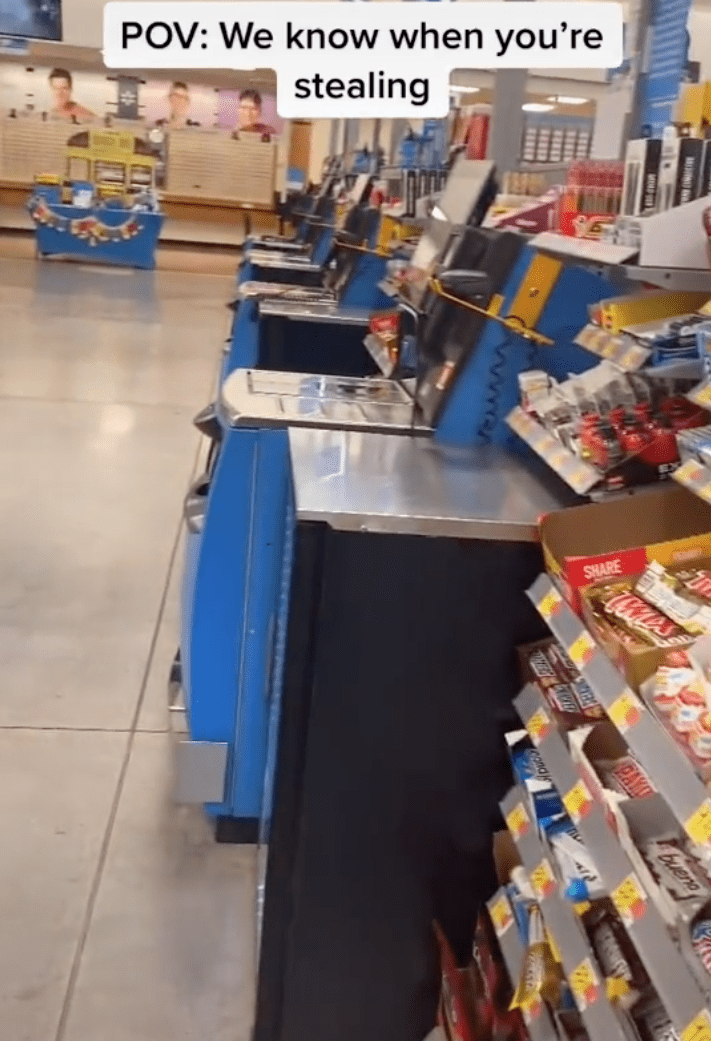 Purported Walmart employee pans the store to show viewers they are being tracked at the self-service section | Photo: TikTok/thewalmartguy69