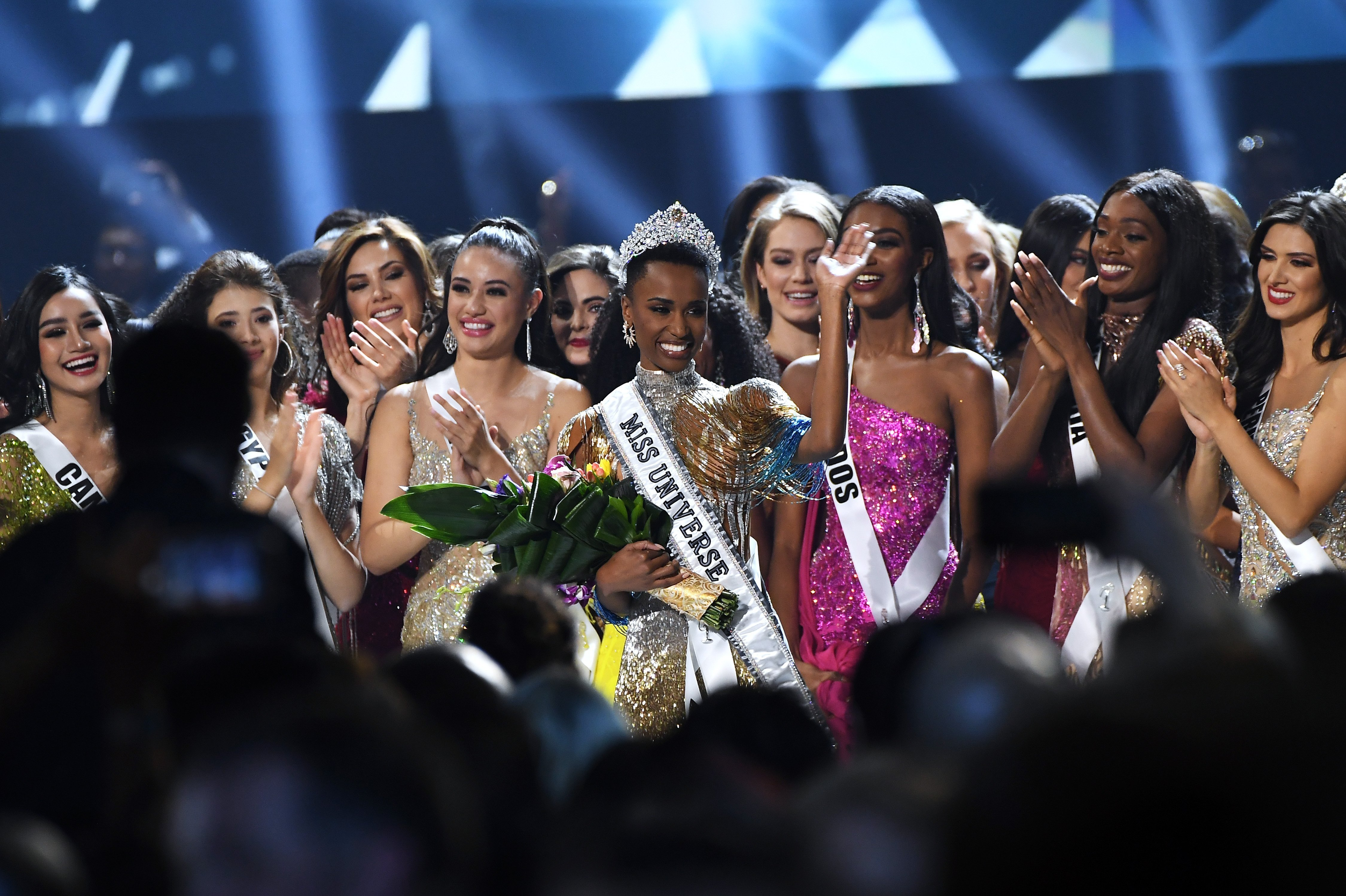 South African Zozibini Tunzi stands out amid a sea of beautiful women as she is crowned Miss Universe 2019. | Photo: Getty Images