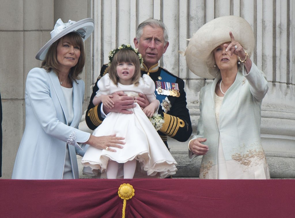 Carole Middleton, Prince Charles, and Camilla Parker-Bowles holding Eliza Lopes on April 29, 2011. | Photo: Getty Images
