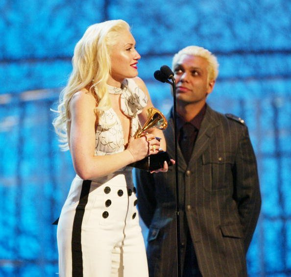Gwen Stefani and Tony Kanal of No Doubt accept the Grammy for Best Pop Performance By A Duo Or Group With Vocal at the 46th Annual Grammy Awards held at the Staples Center on February 8, 2004, in Los Angeles, California. | Source: Getty Images.