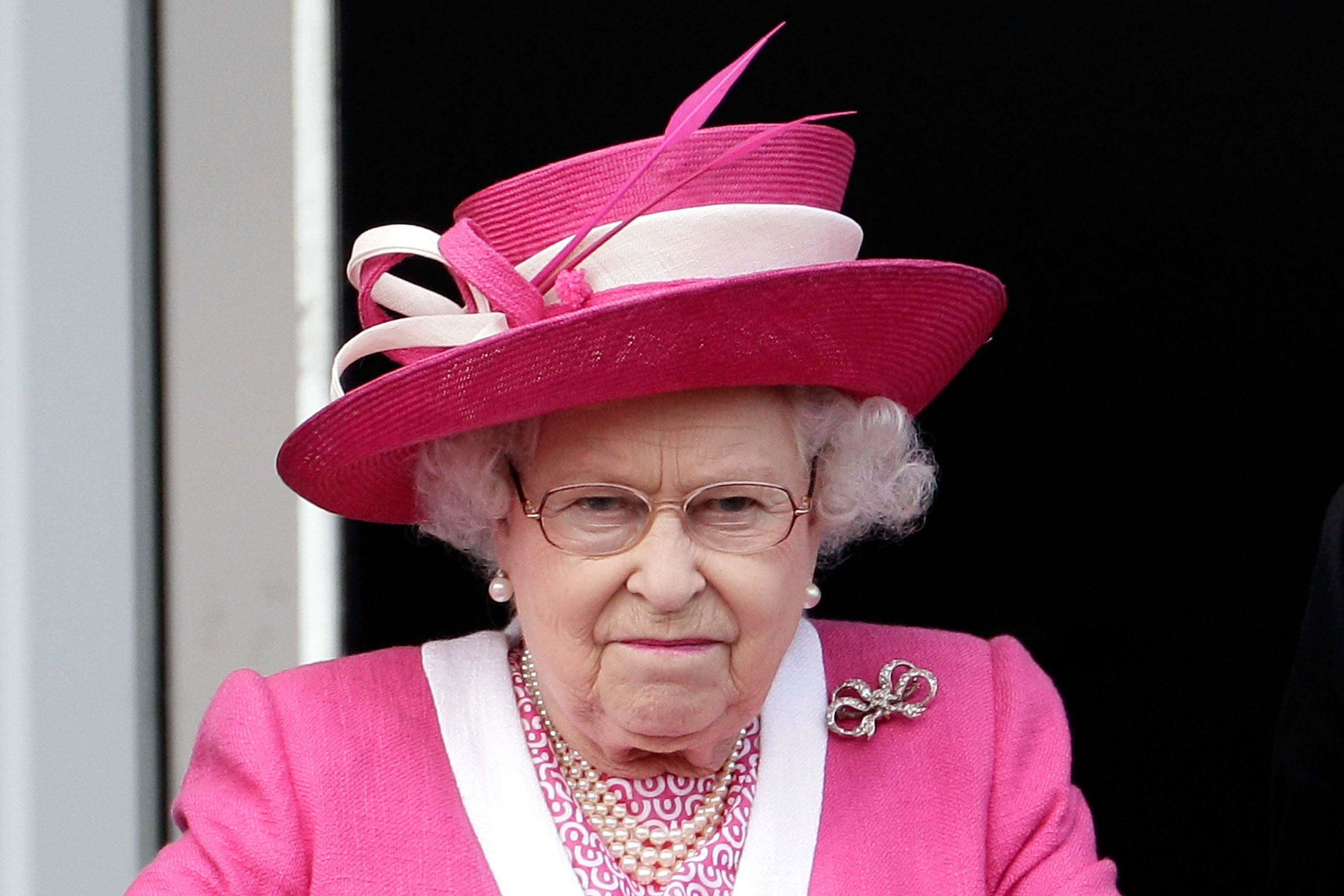 Queen Elizabeth II reacts after her horse Carlton House comes in third in the Epsom Derby at Epsom Downs racecourse | Photo: Getty Images