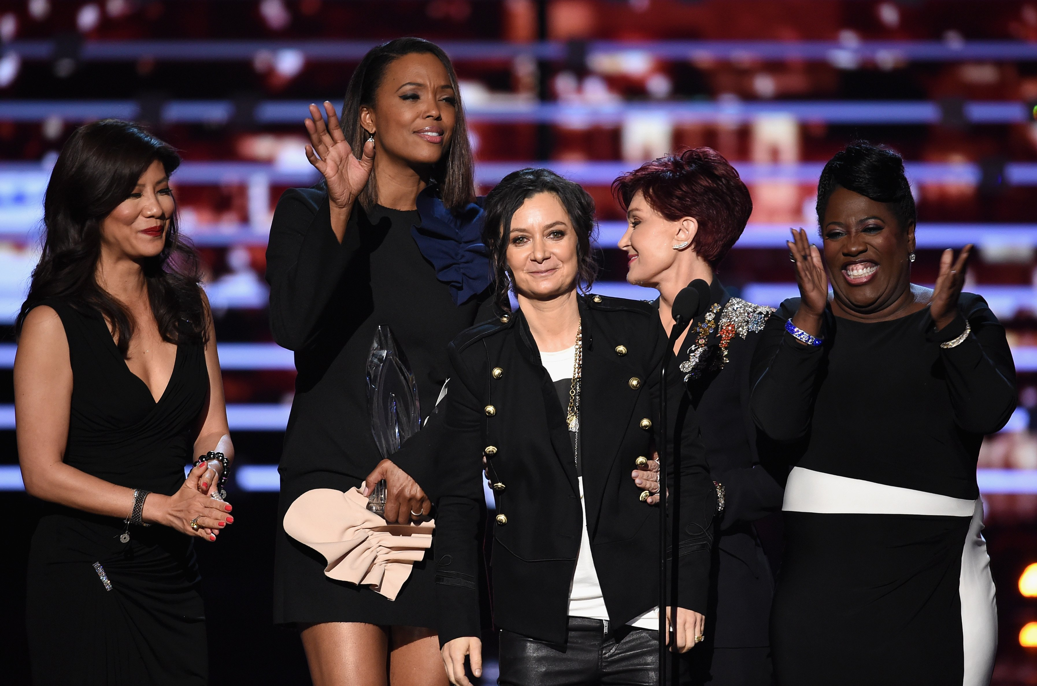 """TV personalities Julie Chen, Aisha Tyler, Sara Gilbert, Sharon Osbourne, and Sheryl Underwood win the award for Favorite Daytime Talk Show Hosting Team for """"The Talk"""" at the People's Choice Awards in Los Angeles on January 6, 2016 