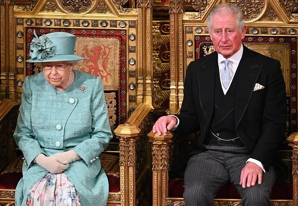 Queen Elizabeth II and Prince Charles, Prince of Wales attend the State Opening of Parliament in the House of Lord's Chamber in London, England | Photo: Getty Images