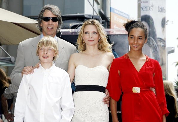 David E Kelley, Michelle Pfeiffer and their two children, John and Claudia, pictured attending Pfeiffer's Star Ceremony at the Hollywood Walk of Fame, 2007, Los Angeles, California. | Photo: Getty Images