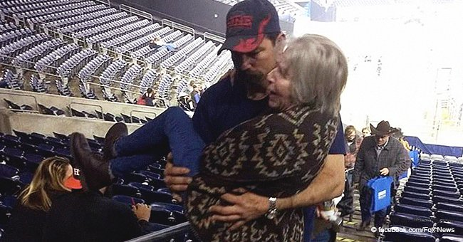 Fire Department Captain Carried Elderly Lady in His Arms to Help Her up the Stairs