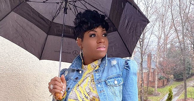 Pregnant Fantasia Cradles Her Growing Baby Bump Wearing a Yellow Dress & Denim Jacket (Photo)