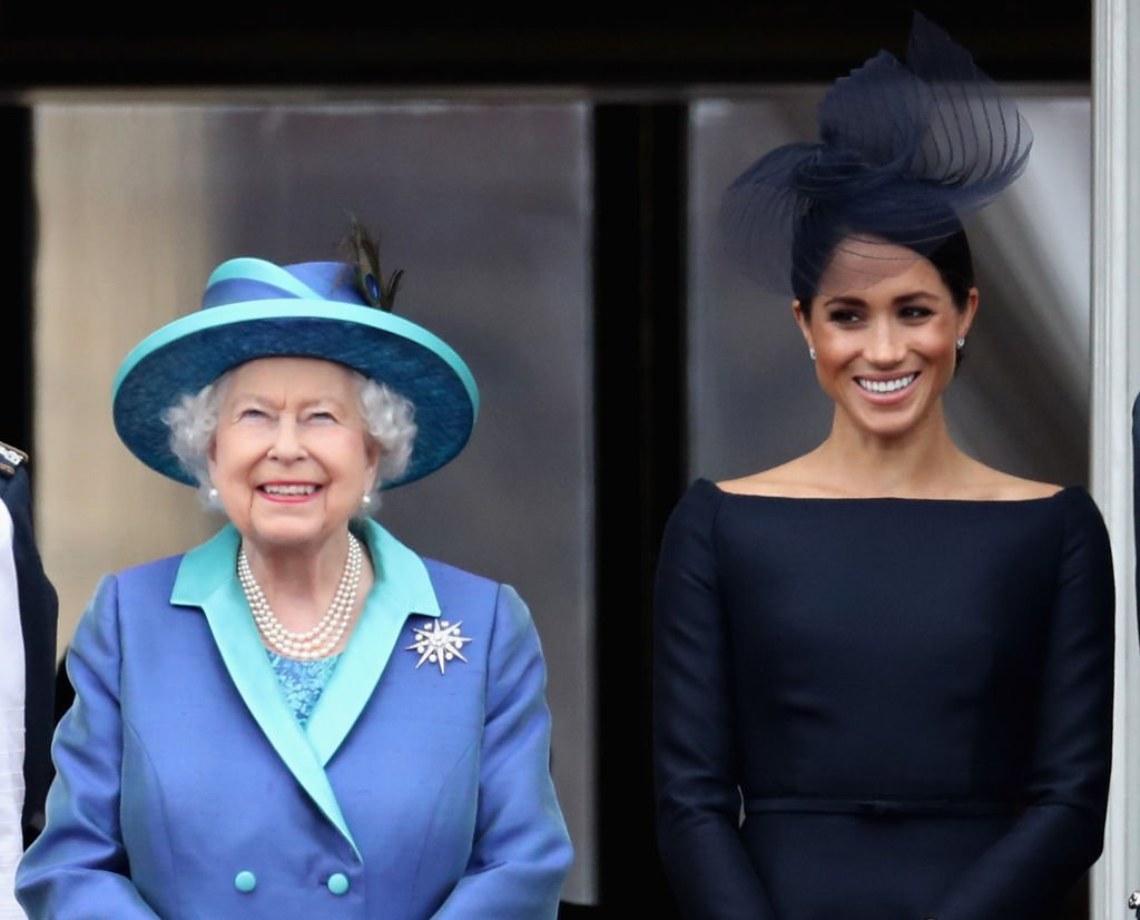 Queen Elizabeth II and Meghan, Duchess of Sussex watch the RAF flypast on the balcony of Buckingham Palace, as members of the Royal Family attend events to mark the centenary of the RAF | Photo: Getty Images