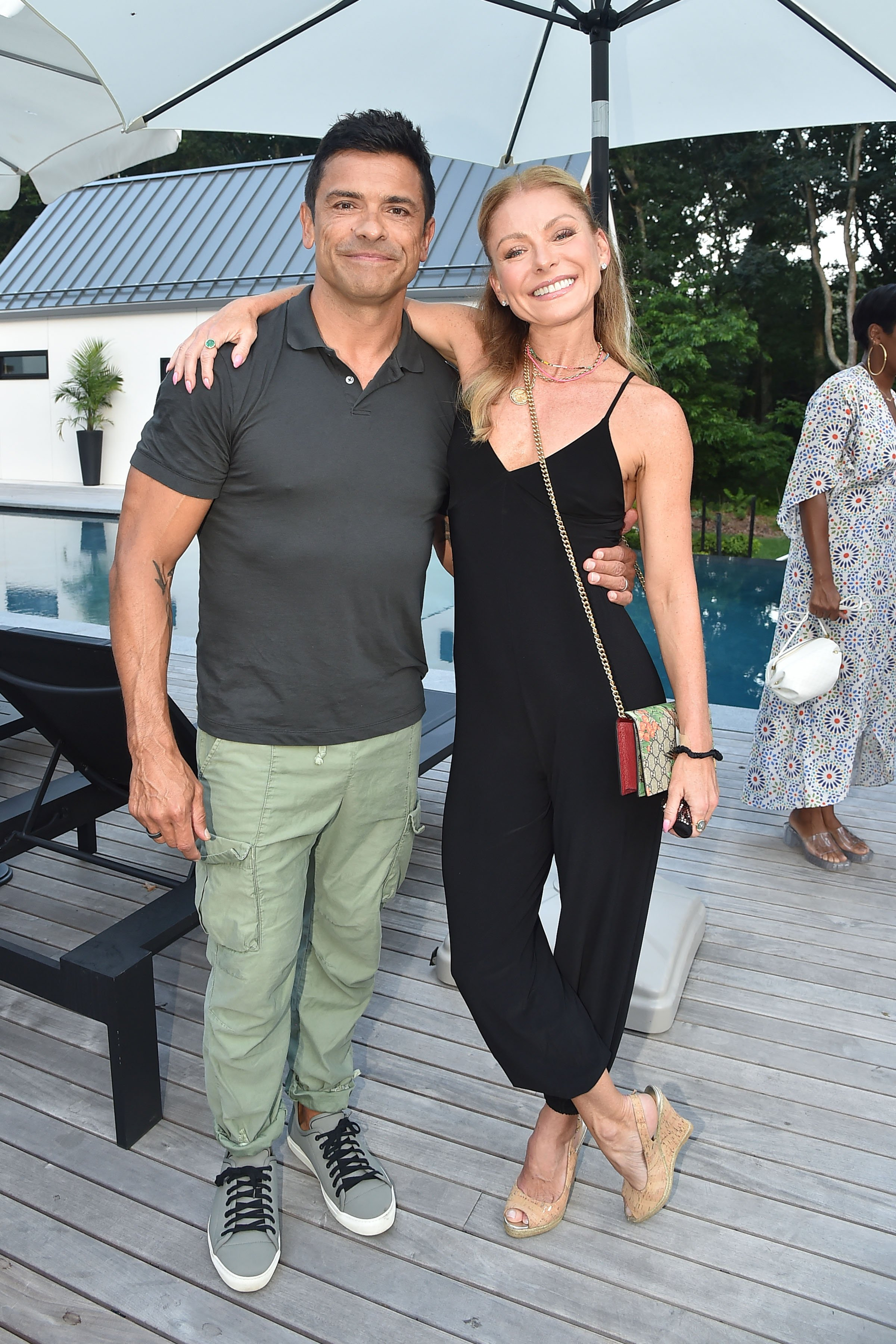 Mark Consuelos and Kelly Ripa at the Launch Of Yoga Pant Nation By Laurie Gelman in Water Mill, New York City | Photo: Patrick McMullan via Getty Images