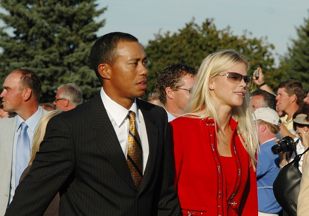Tiger Woods and Elin Nordegren leave the stage after opening ceremonies at the 2004 Ryder Cup in Detroit, Michigan, September 16, 2004. | Source: Getty Images