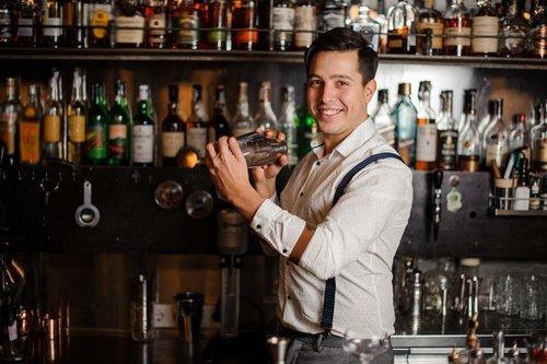 A smiling bartender.   Source: Shutterstock.