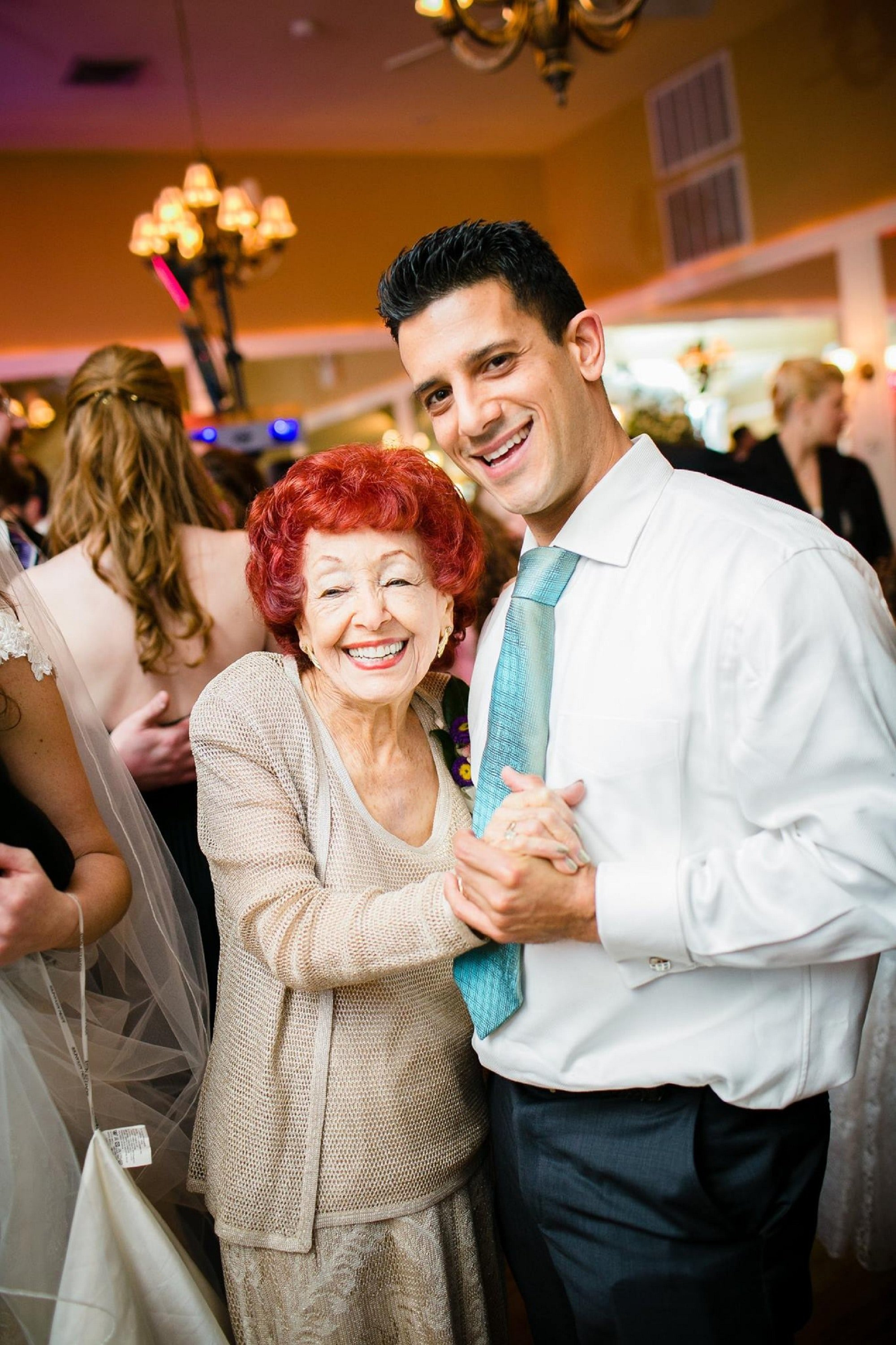 A young man and his grandmother dancing. | Source: Unsplash