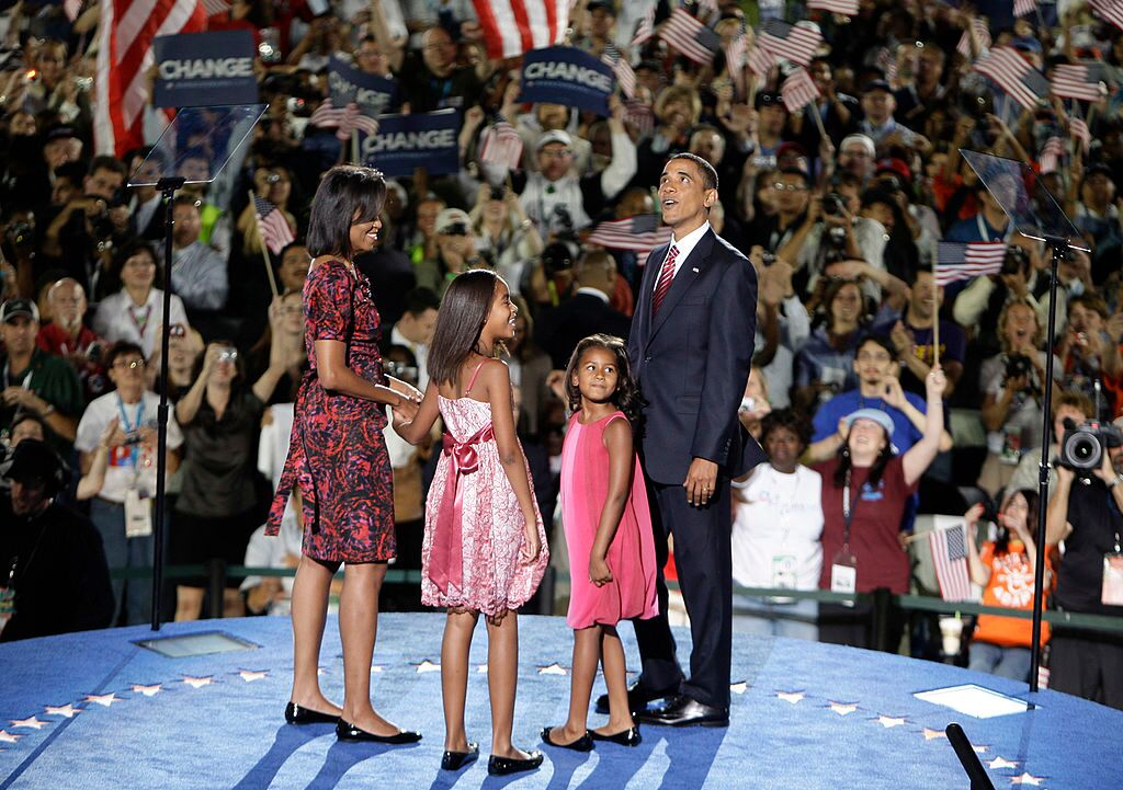 Michelle Obama, Malia Obama, Sasha Obama and U.S. Sen. Barack Obama stand on stage delegates after he accepted the Democratic presidential nomination at Invesco Field at Mile High | Getty Images