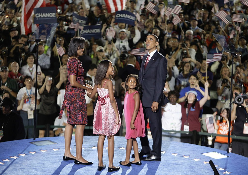 (L-R) Michelle Obama, Malia Obama, Sasha Obama & Barack Obama stand on stage after he accepted the Democratic presidential nomination on Aug. 28, 2008 in Denver, Colorado | Photo: Getty Images