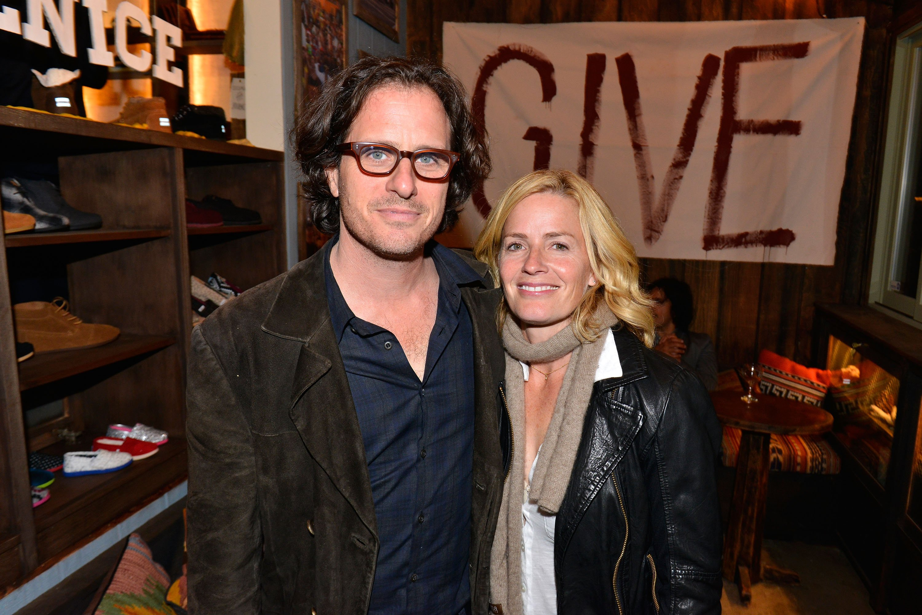 Davis Guggenheim and actress Elisabeth Shue attend the Grand Opening of TOMS official flagship store on December 17, 2012, in Venice, California. | Source: Getty Images.