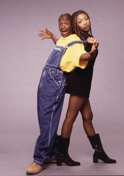 "Lamont Bentley (as Hakeem Campbell) and Brandy Norwood (as Moesha Mitchell) on the UPN half-hour comedy series ""Moesha.""  
