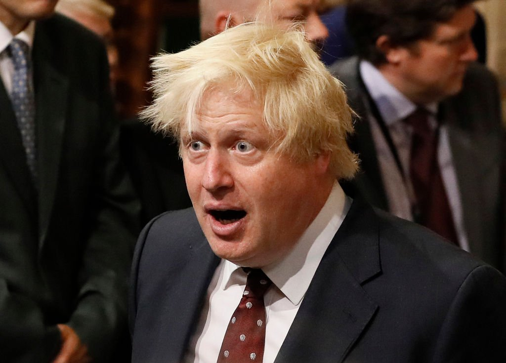 British Foreign Secretary Boris Johnson walks through the House of Commons to attend the the State Opening of Parliament taking place in the House of Lords at the Palace of Westminster | Photo: Getty Images