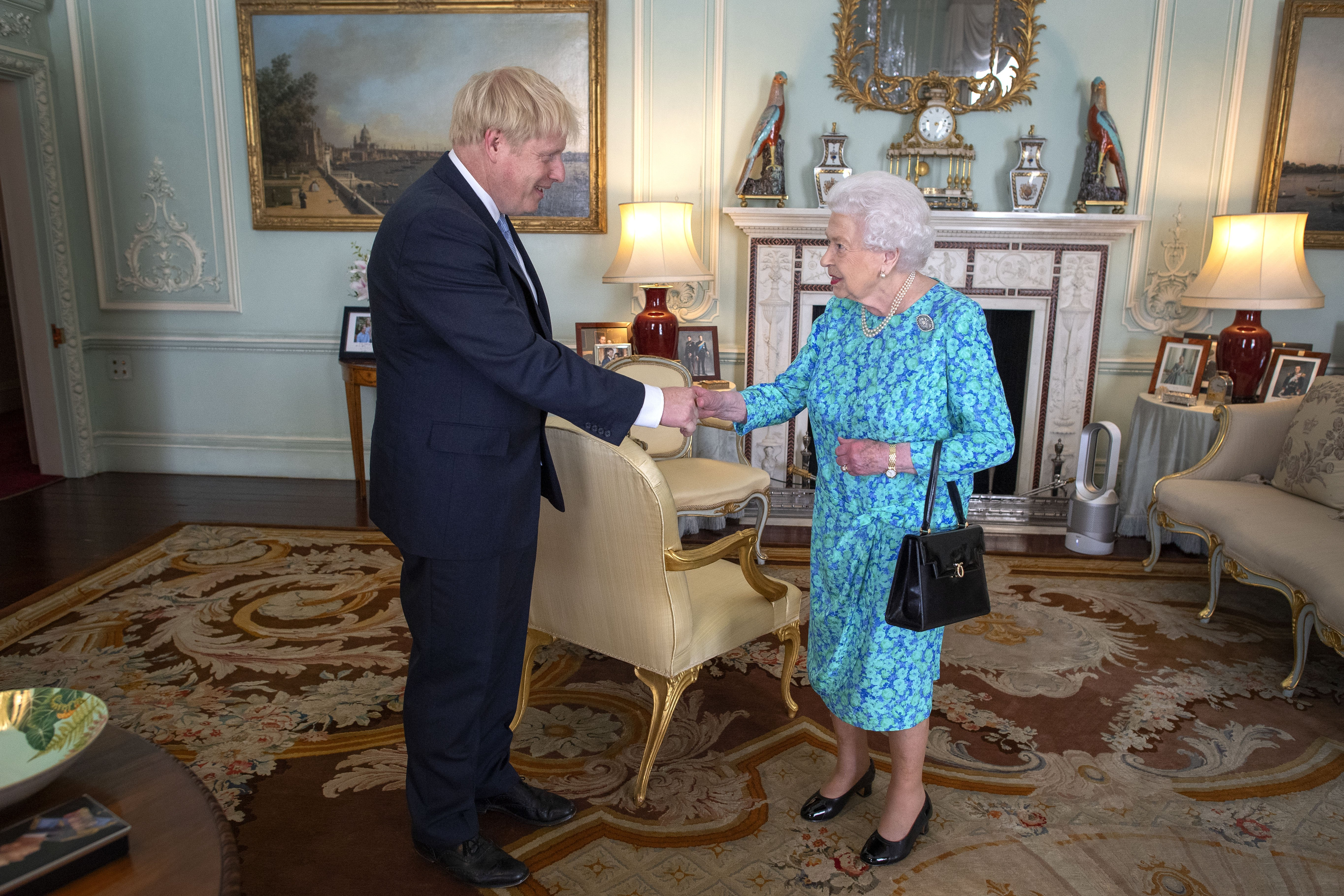 Queen Elizabeth II welcomes Boris Johnson in Buckingham Palace on July 24, 2019, in London, England. | Source: Getty Images.