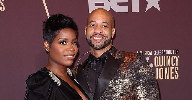 Fantasia and Spouse Kendall Cradle Her Growing Baby Bump With Headphones on It in a New Photo