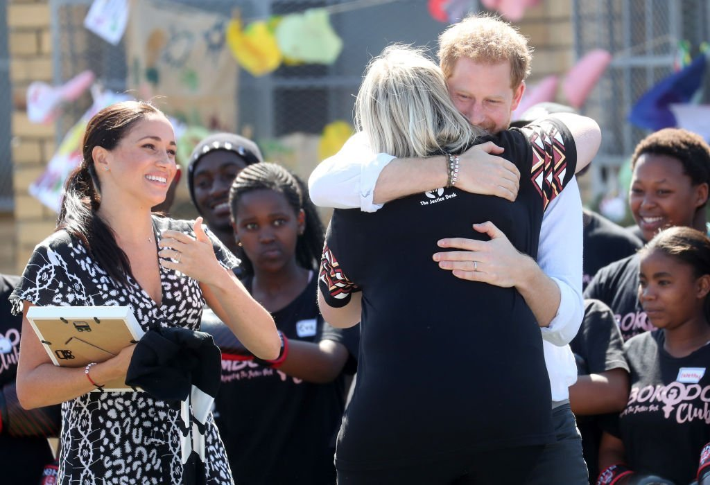 Prince Harry hugs Jessica Dewhurst, Justice Desk Founder, during the visit to a Justice Desk initiative in Nyanga township. | Source: Getty Images