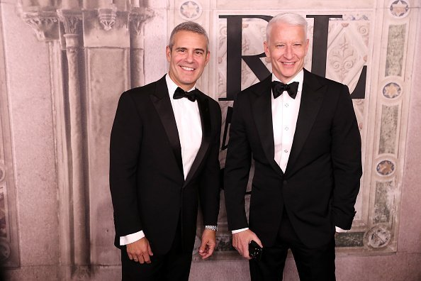 Andy Cohen and Anderson Cooper attend the Ralph Lauren fashion show during New York Fashion Week at Bethesda Terrace | Photo: Getty Images