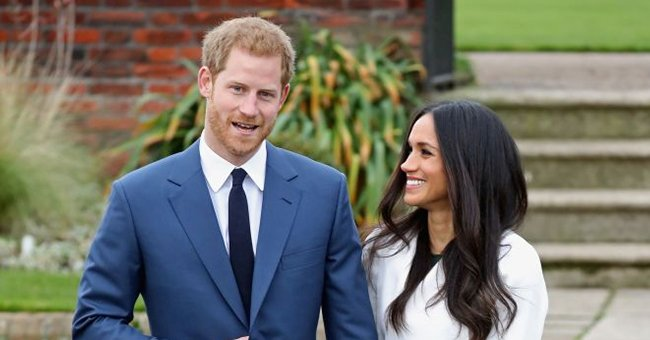 Prince Harry & Meghan's Pregnancy Photo Faces Backlash as the Duke Is Mocked for His Bare Feet