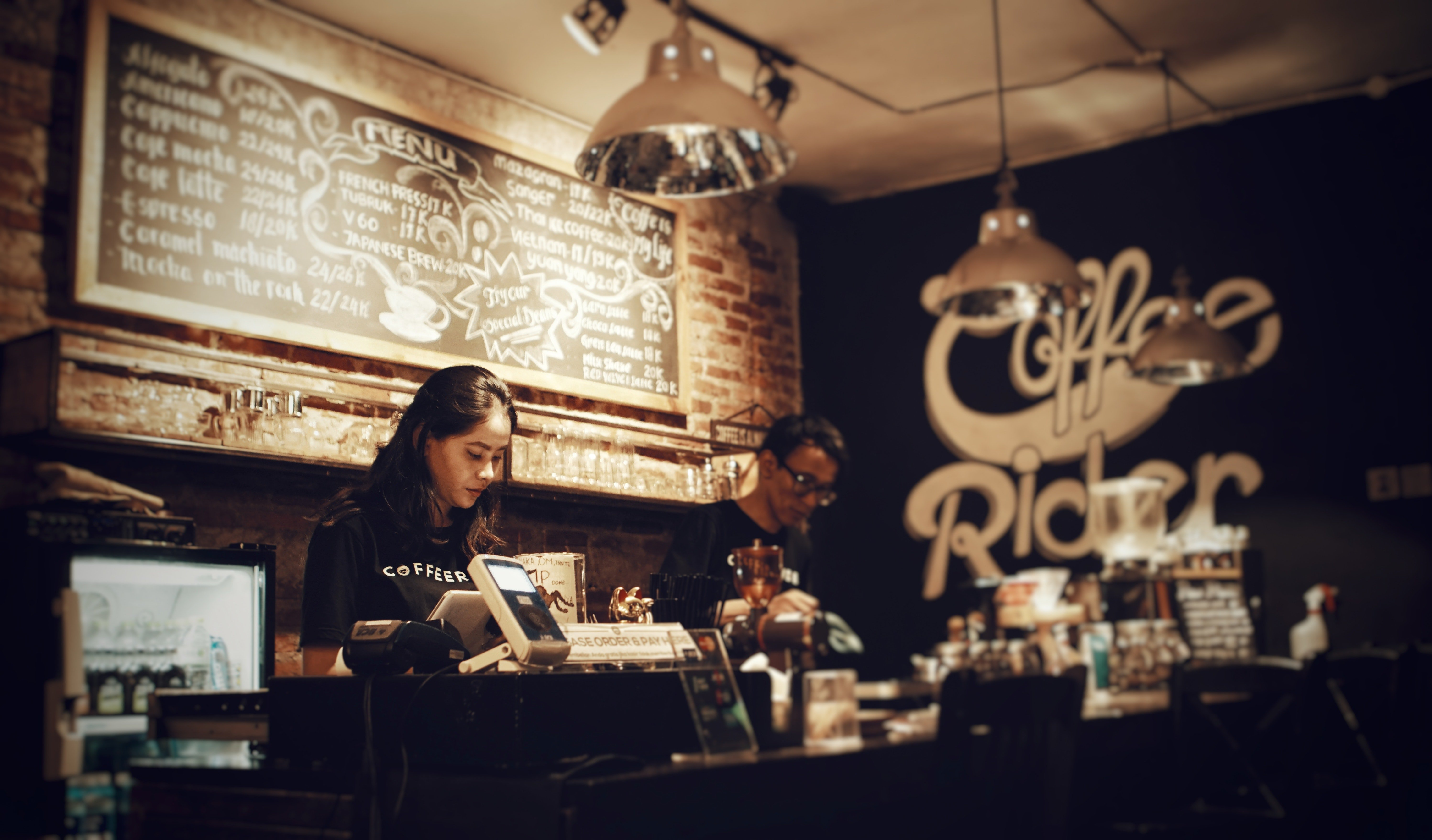A cashier working at the counter   Source: Pexels.com