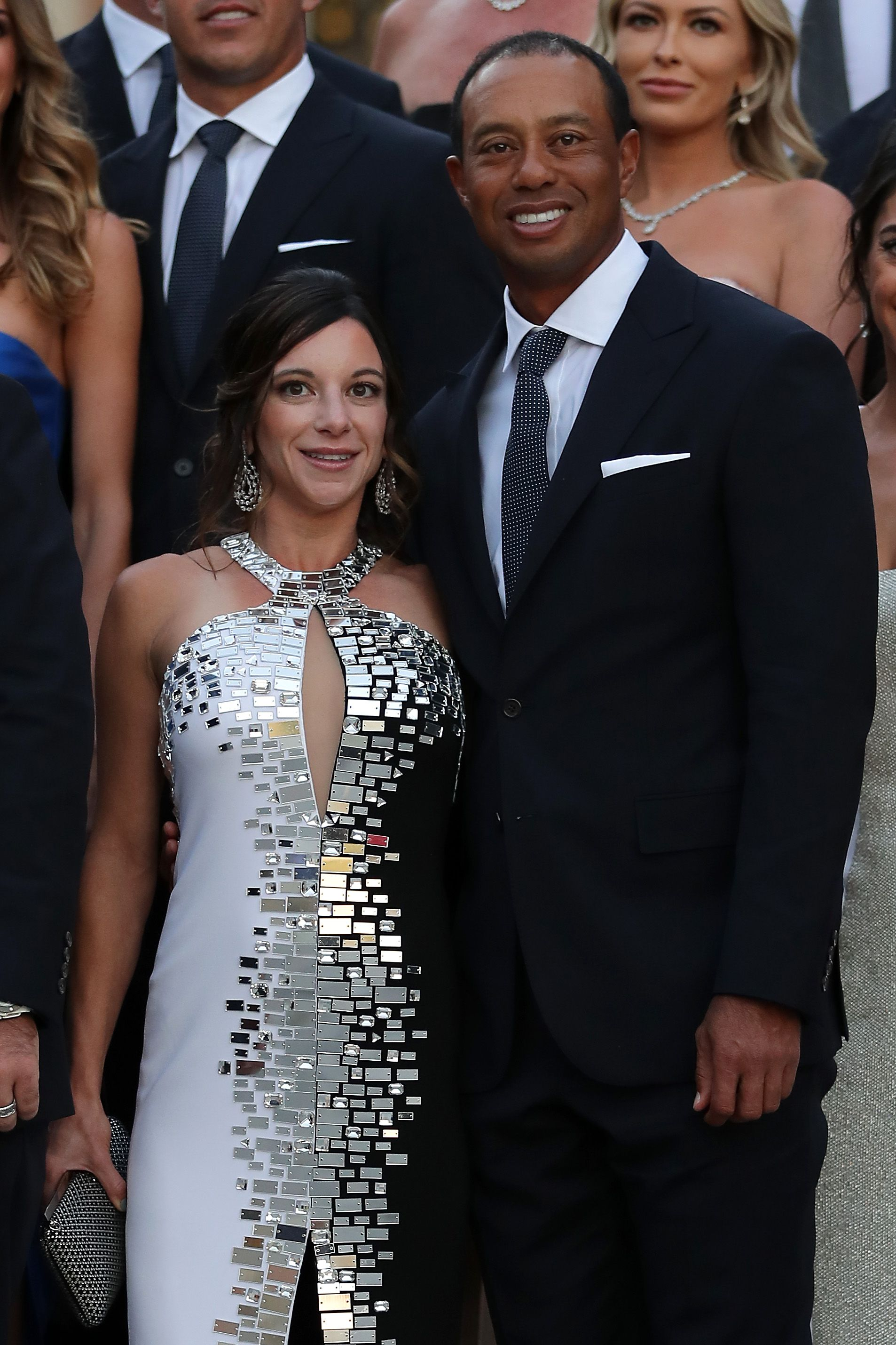 Tiger Woods poses with girlfriend Erica Herman before the Ryder Cup gala dinner at the Palace of Versailles ahead of the 2018 Ryder Cup on September 26, 2018 in Versailles, France. | Source: Getty Images