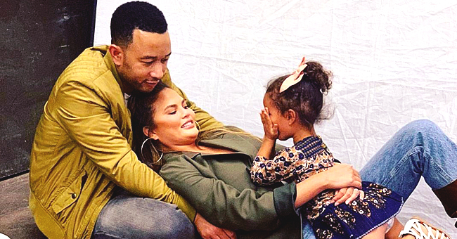 Chrissy Teigen of 'Bring the Funny' Sweetly Cuddles Daughter Luna While Working on Her Cravings Website