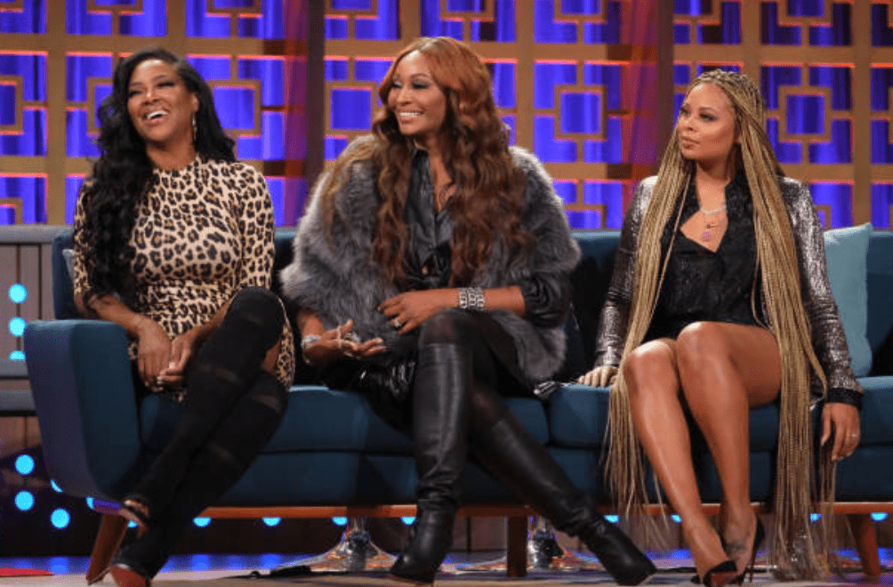"""Kenya Moore, Cynthia Bailey, Eva Marcille sit on stage for an interview during an episode of """"BravoCon"""" on season 16 for """"Watch What Happens Live With Andy Cohen 